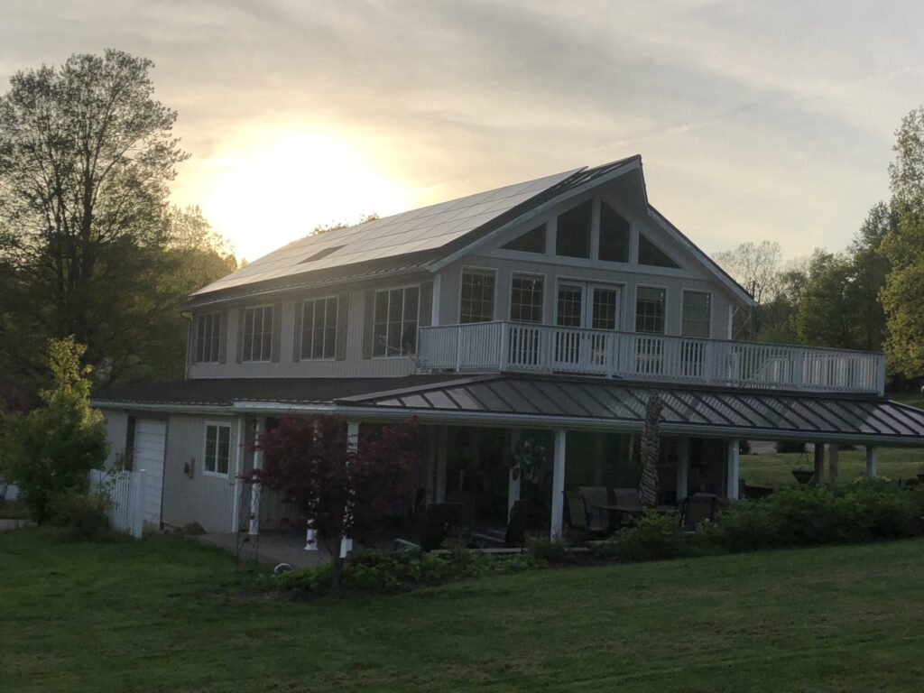 Sunset behind home with new solar array